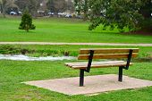 Wooden bench in park.