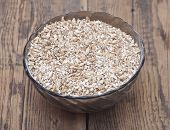 stock photo of malt  - Pale malt barley in a glass bowl - JPG