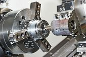 stock photo of turn-up  - industrial metal work bore machining process by cutting tool on automated lathe - JPG