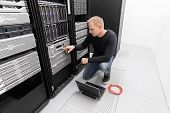image of racks  - It engineer or consultant working with backup server - JPG