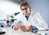 Chemical Laboratory Technician Holding Magnifier