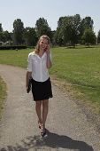 Pretty Businesswoman In The Park; On The Phone