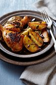 Oven-baked chicken and potatoes with pumpkin seeds