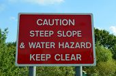 Caution steep slope sign.