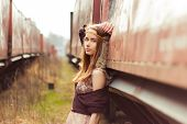 stock photo of hippy  - beautiful hippie girl with red hair and big lips stands near the old car near the  railroad - JPG