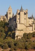 Castle And Cathedral At Sunset In Segovia. Alcazar