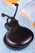 image of castanets  - Spanish flamenco castanets on a polka dot fabric - JPG