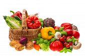 stock photo of wooden basket  - fresh vegetables and herbs on wooden background - JPG