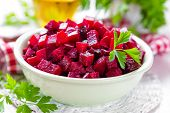 foto of beet  - Fresh salad with boiled beets on a plate - JPG