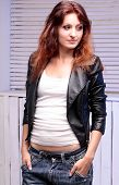 Beautiful Woman In Jeans And Black Leather Jacket