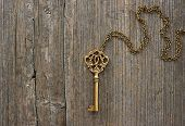 Antique Golden Key Over Wooden Background