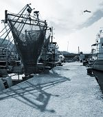 Moored Fishing Boats With Drying Nets. Monochrome Photo