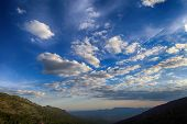 Clouds Over A Mountain Valley