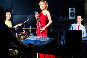 Asian professional recording studio mixing new song of band