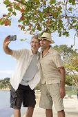 Gay couple taking a selfie with phone