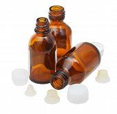 Three Empty Open Amber Glass Pharmacy Bottles