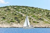 Yacht With White Sail Near Dalmatia Coast