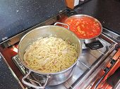 picture of caboose  - cooking pasta with sausage and meat gravy on stove in yacht galley - JPG