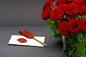 Bouquet Of Red Roses And Love Letter On Black