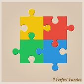 Four Colourful Puzzle Pieces.