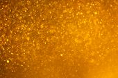abstract golden background with particles