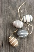 Decorative Ceramic Eggs On Wooden Background