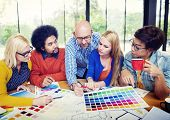Designers Working and Brainstorming in a Meeting