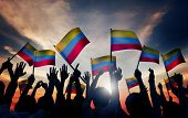 Group of People Waving Colombian Flags in Back Lit