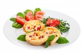 Plate of Mini quiche on a white background filled with vegetables with salad.Focus on the front pies