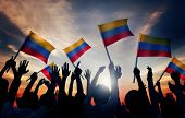 Silhouettes of People Holding Flag of Colombia