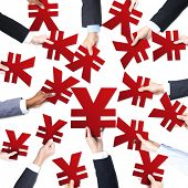 Group of Business People's Hands Holding Yen Symbols