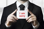 Businessman Holding Sign I Am Sorry