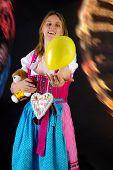 Woman In Dirndl Enjoying Fun Fair