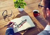 A Man Brainstorming about Symptom Concept