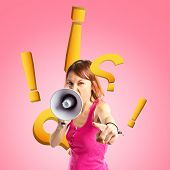 Redhead Girl Shouting With A Megaphone Over Pink Background