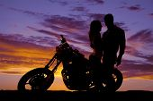 Silhouette Couple Look At Each Other On Motorcycle