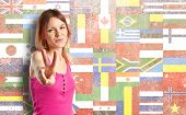 Pretty Young Woman Winner Over Flags Background
