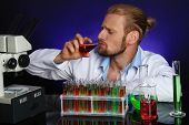 picture of mad scientist  - Crazy scientist working in laboratory - JPG