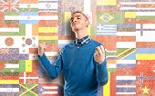 Young Man Winner Over Flags Background
