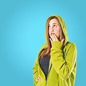 Girl Doing Surprise Gesture Over Blue Background