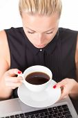 Business woman with cup of coffee.