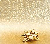 Golden Ribbon Bow On Shiny Background