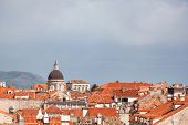 View on Dubrovnik Old town's beautiful rooftops on sunny day with copyspace on upper part.