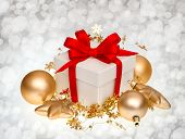 White Gift Box With Red Ribbon Bow And Golden Balls