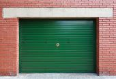 Green Metal Garage Gate In Red Brick Wall, Background Texture