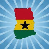Ghana map flag on blue sunburst illustration