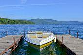 Yellow Boat At Dock On A Lake