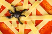 stock photo of cobweb  - Closeup take of a tomato and cheese cobweb a Halloween pizza - JPG