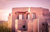 Adobe architecture style house Arizona warm summer evening