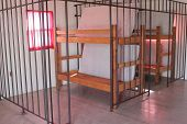 A double bunk in a pretend jail cell.
